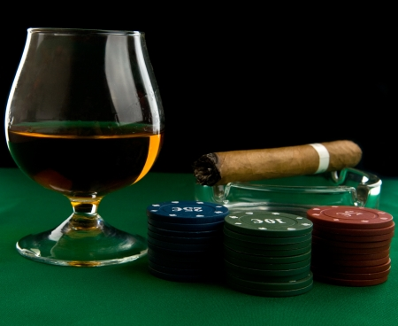 alcohol, chips and cigar on a black background photo