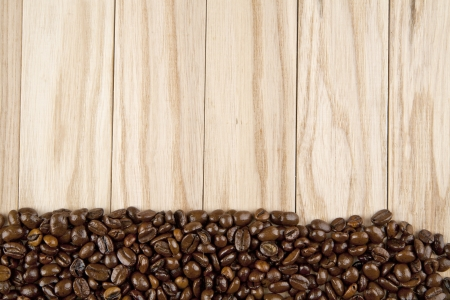 grains of coffee on a wooden background photo