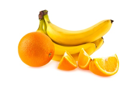 oranges and bananas on a white background photo