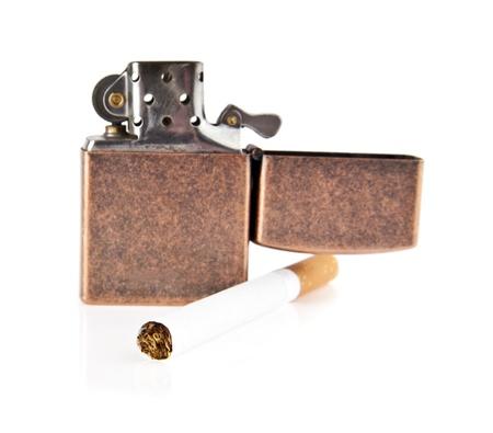 cigarette-lighter and cigarette on a white background Stock Photo - 16473338