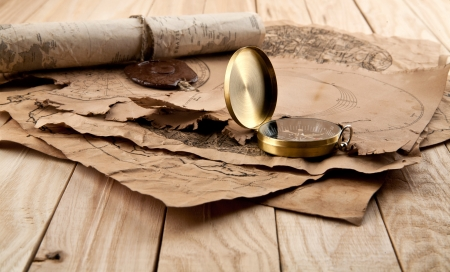 old papers and compass on wooden stome Stock Photo - 16474797