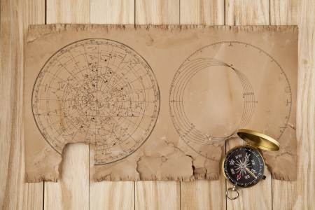 old papers and compass on wooden stome Stock Photo - 16474918