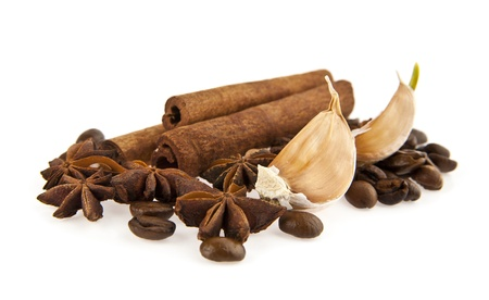 flavorings: grains of coffee and seasoning on a white background
