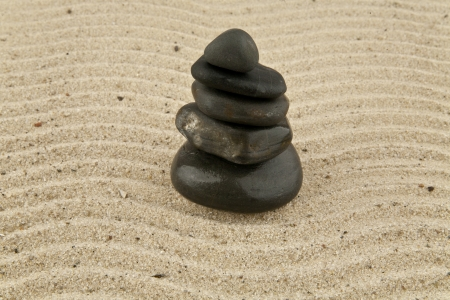 pyramid from stone on sand photo