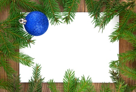 christmas decorations  and branches of fir-tree on a wooden background photo