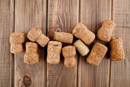 corks on a wooden table photo