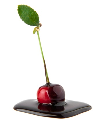 blanketed: cherry in a chocolate on a white background