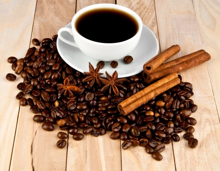 cup of coffee and grain on a wooden table Stock Photo - 16474774