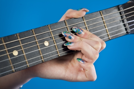 guitar fretboard on a blue background photo