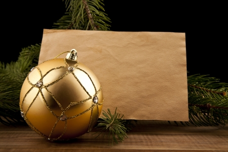 Christmas decoration and old paper on the black background photo