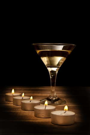 glass of wine and candles on a black background Stock Photo