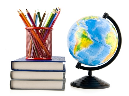 books, pencils and globe on a white background  photo