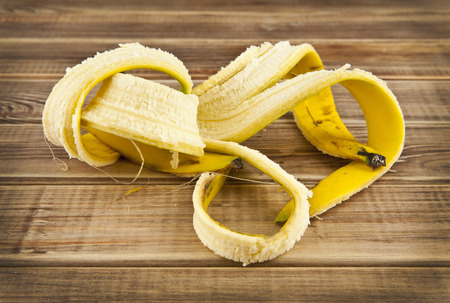 skin of banana on a wooden table