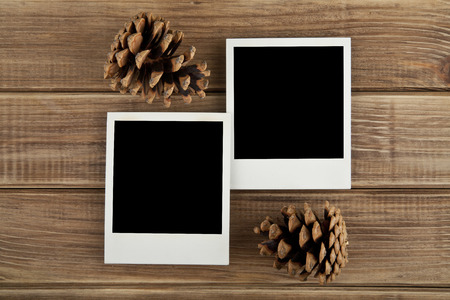confines: pictures and cones on a wooden background