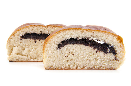 roll with poppy seeds on a white background photo