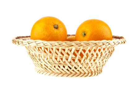 oranges in a basket on a white background photo