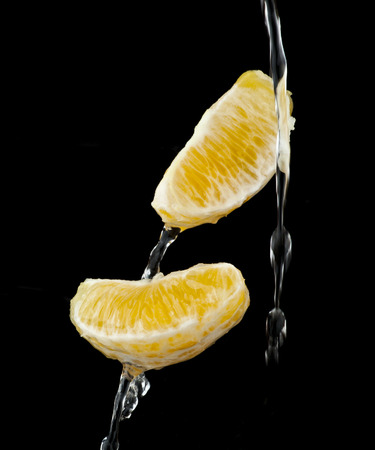 gustatory: orange in water on a black background Stock Photo