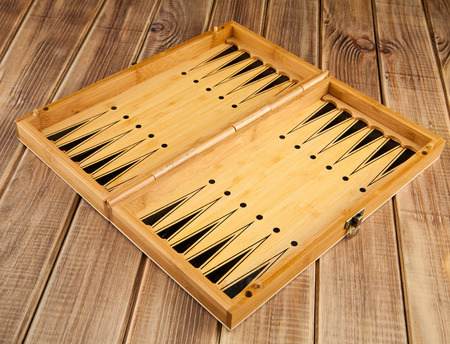 Board game of backgammon on a wooden table Stock Photo