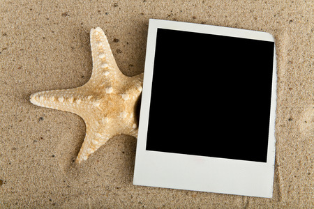 starfish and picture on sand photo
