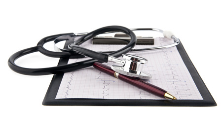 blank medical clipboard with stethoscope on white background photo