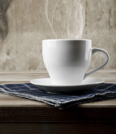 time flies: cup of coffee on a wooden background