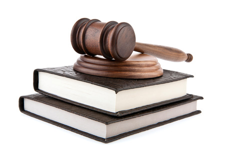 legal court: a wooden mallet and a book on a white background Stock Photo