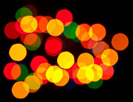 distant spot: coloured specks of light on a black background
