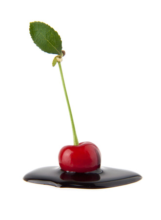 blanketed: juicy cherry in a chocolate on a white background Stock Photo