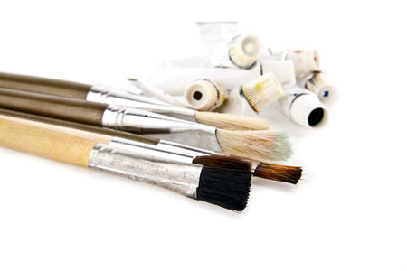brushes and tubes with a paint on a white background photo