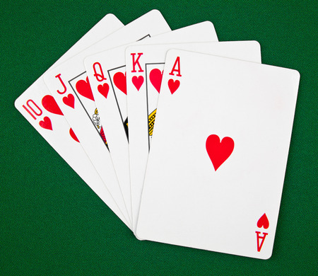 playing-cards on a green canvas Stock Photo - 25808116