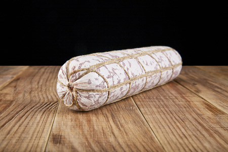 salame: salame on a wooden table Stock Photo