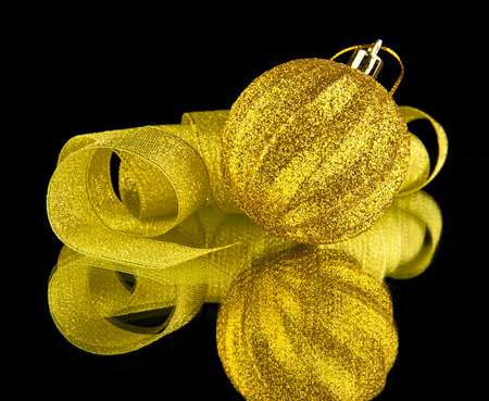 ribbon christmas decoration on a black background photo