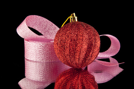 ribbon and new-year decoration on a black background photo