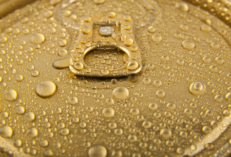 inhibited: jar of beer drops of water on a gold background