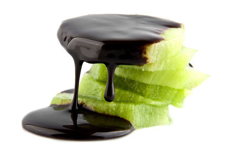 blanketed: kiwi fruit in chocolate on a white background