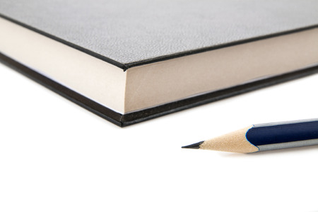 pencil and book on a white background photo