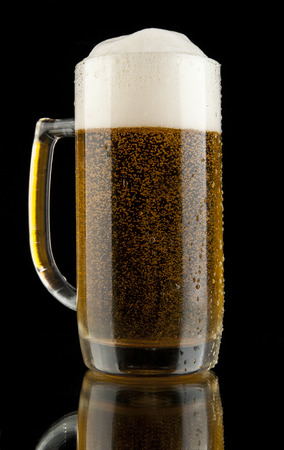 glass beer on a black background photo