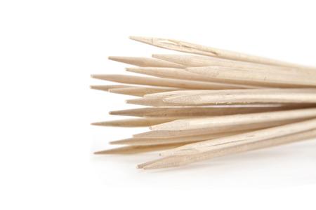 sticks for a shashlick on a white background photo