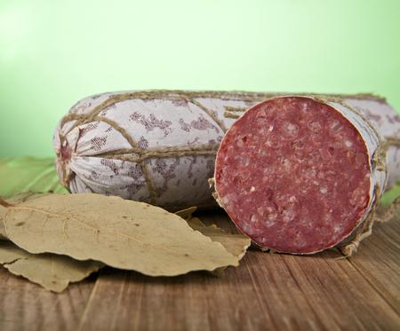 longaniza: salame on a green background