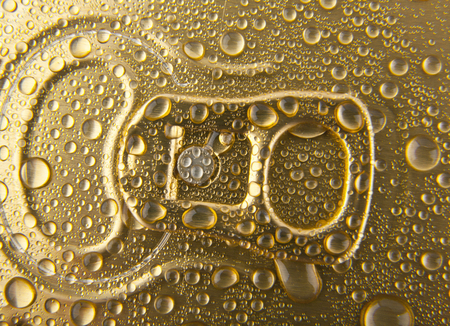 inhibited: can of beer in drops of water as a background