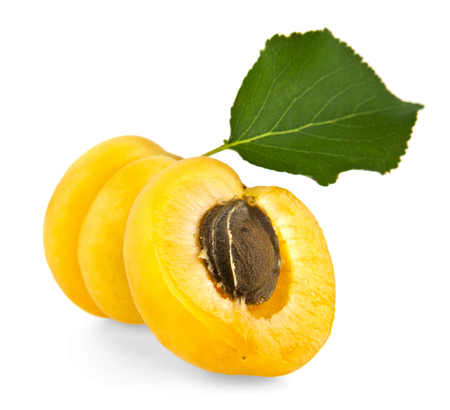 bisected: apricots on a white background