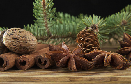 sliced tree: branches of fir-tree and seasoning on a black background