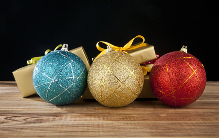 newyear: gifts and new-year decorations on a black background Stock Photo