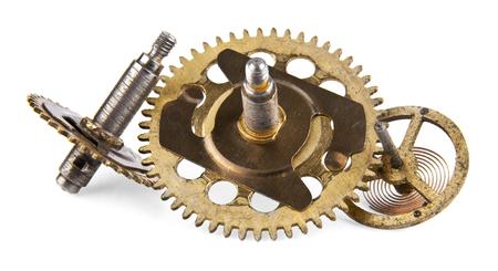 reloj de pendulo: piezas de repuesto para un reloj mecánico sobre un fondo blanco Foto de archivo