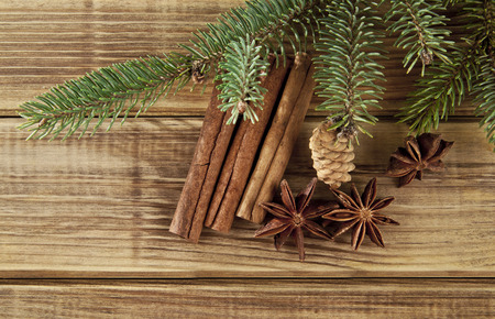 sliced tree: branches of fir-tree and seasoning on a wooden background