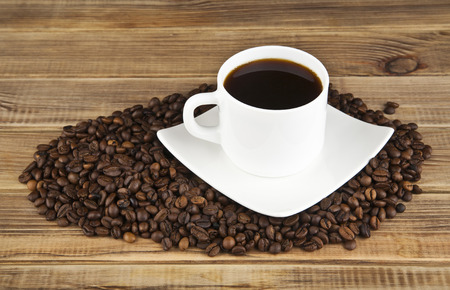 colombian food: cup of coffee on wooden background