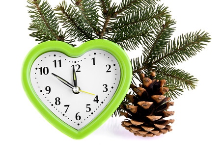 mict: branch of Christmas tree, clock and cone on a white background