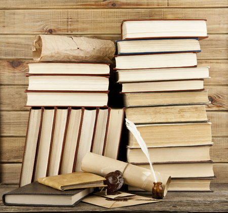 old books on a wooden background Stock Photo