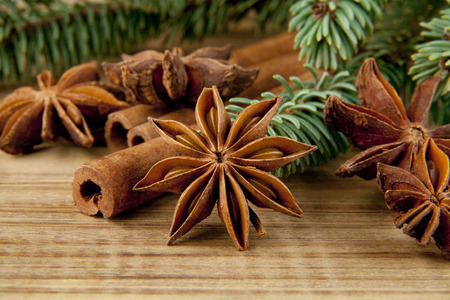 sliced tree: spices and branch of Christmas tree on wooden table