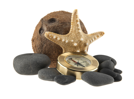 starfish, coconut, stones, and compass isolated on white background Stock Photo